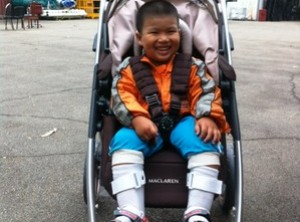 Maclaren strollers change lives / https://www.crossroads.org.hk/wp-content/uploads/2014/03/HongKong_child_in_wagon.jpg