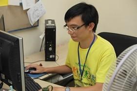 Hongkong_man_sitting_at_a_computer