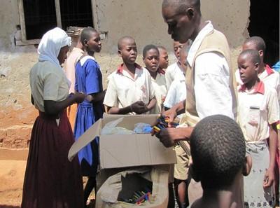 Uganda_donation_in_box