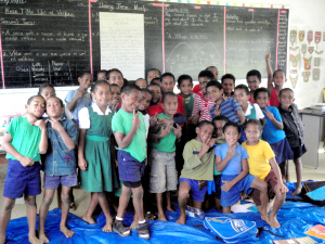 Fiji village schoolchildren are ready to learn but struggle with few resources.
