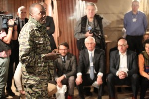 Former child soldier David Livingstone speaks to participants at Crossroads' Refugee Run simulation in Davos, Switzerland at the World Economic Forum