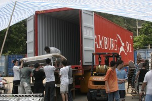 Goods for the hospital and school are loaded into the container at Crossroads in Hong Kong.